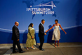 Pittsburgh, PA - September 24, 2009 -- United States President Barack Obama (2L) and U.S. first lady Michelle Obama (R) welcome South African President Jacob Zuma (L) and his wife Nompumelelo Ntuli to the opening dinner for G-20 leaders at the Phipps Conservatory on September 24, 2009 in Pittsburgh, Pennsylvania. Heads of state from the world's leading economic powers arrived today for the two-day G-20 summit held at the David L. Lawrence Convention Center aimed at promoting economic growth..Credit: Win McNamee / Pool via CNP