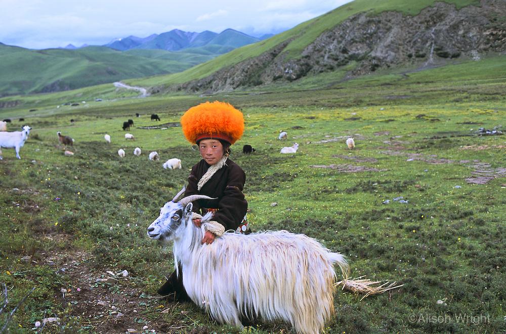 Orange hat boy in Deganga Valley, Kham, eastern Tibet, 2005