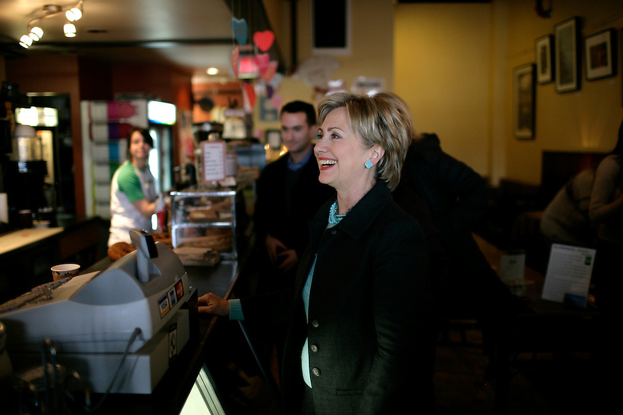 U.S. Senator and Democratic presidential hopeful Hillary Rodham Clinton (D-NY) (R) orders a chai at Brewbakers coffee shop in Keene, New Hampshire February 11, 2007.<br /> Photo by Brooks Kraft/Corbis