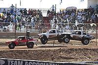 Apr 16, 2011; Surprise, AZ USA; LOORRS driver Wyatt Kirchner (26) leads Jason Ellis (89) and Matt Cook (55) during round 3 at Speedworld Off Road Park. Mandatory Credit: Mark J. Rebilas-.