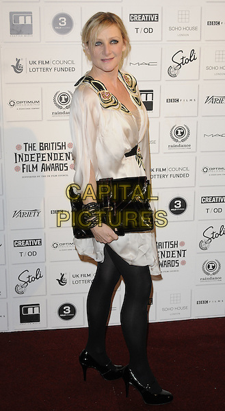 LESLEY SHARP.Attending The British Independent Film Awards,The Brewery, London, England, UK, December 6th 2009. .arrivals full length black tights shoes clutch bag patent white dress waistband beaded gold studs studded cream .CAP/CAN.©Can Nguyen/Capital Pictures