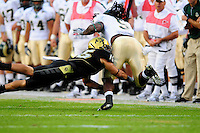 31 Aug 2008: Colorado free safety Ryan Walters (15) tackles Colorado State running back Gartrell Johnson. The Colorado Buffaloes defeated the Colorado State Rams 38-17 at Invesco Field at Mile High in Denver, Colorado. FOR EDITORIAL USE ONLY