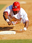 8 March 2006: Marlon Byrd, outfielder for the Washington Nationals, dives safely back to first base during a Spring Training game against the St. Louis Cardinals. The Cardinals defeated the Nationals 7-4 in 10 innings at Space Coast Stadium, in Viera, Florida...Mandatory Photo Credit: Ed Wolfstein.