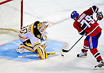22 November 2008: Boston Bruins' goaltender goaltender Tim Thomas makes a save against Montreal Canadiens' defenseman Andrei Markov from Russia during an overtime shootout at the Bell Centre in Montreal, Quebec, Canada.  After a 2-2 regulation tie and a non-scoring 5-minute overtime period, the Boston Bruins scored the lone shootout goal thus defeating the Canadiens 3-2. The Canadiens, celebrating their 100th season, honored former Montreal goaltender Patrick Roy, and retired his jersey (Number 33) during pre-game ceremonies. ***** Editorial Use Only *****..Mandatory Photo Credit: Ed Wolfstein Photo *** Editorial Sales through Icon Sports Media *** www.iconsportsmedia.com