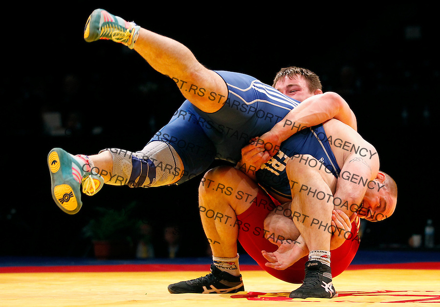 BELGRADE, SERBIA - MARCH 06: Adrian Recorean of Romania (L), fights against Radoslaw Baran of Poland (R), in the Men's Freestyle 96kg during the European wrestling championship March 06, 2011 in Belgrade, Serbia.(Photo by Srdjan Stevanovic/Getty Images)