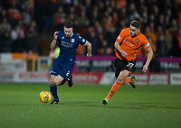 27th December 2019; Dens Park, Dundee, Scotland; Scottish Championship Football, Dundee Football Club versus Dundee United; Cammy Kerr of Dundee is chased by Louis Appere of Dundee United  - Editorial Use