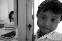Health center Cambodia. A young boy is wating for her mother at Trapeng Andeuk health center. Trapeng Andeuk, Takeo province, Cambodia-2009