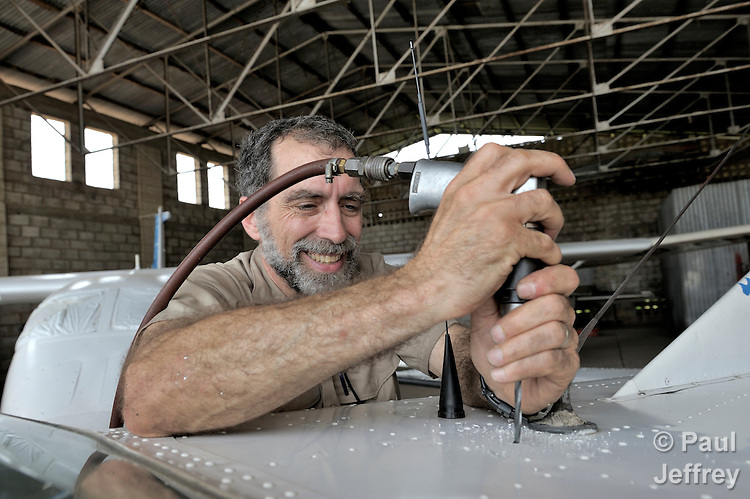 Stephen Quigg, a United Methodist missionary, working in the hangar of Wings of Caring Aviation in Kananga, Congo. The program is sponsored by the United Methodist Church.