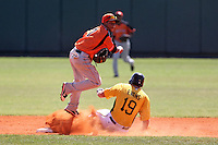 Netherlands National Team second baseman Dwayne Kemp #7 attempts to turn a double play as Nick Evans #19 slides in during a spring exhibition game against the Pittsburgh Pirates at Al Lang Field on March 12, 2012 in St. Petersburg, Florida.  (Mike Janes/Four Seam Images)