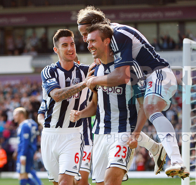 .Football - West Bromwich Albion v Everton - Barclays Premier League - The Hawthorns - Season 12/13 - 1/9/12 .West Brom's Gareth Mcauley celebrates his goal with Jonas Ollson and Liam Ridgewell.Mandatory Credit: Paul Bradbury/Sportimage.EDITORIAL USE ONLY. No use with unauthorized audio, video, data, fixture lists, club/league logos or ?live? services. Online in-match use limited to 45 images, no video emulation. No use in betting, games or single club/league/player publications. Please contact your account representative for further details...