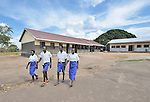 Children in the Southern Sudanese village of Jombo walk home after class from their new school constructed by the United Methodist Committee on Relief (UMCOR). Families here are rebuilding their lives after returning from refuge in Uganda. NOTE: In July 2011, Southern Sudan became the independent country of South Sudan