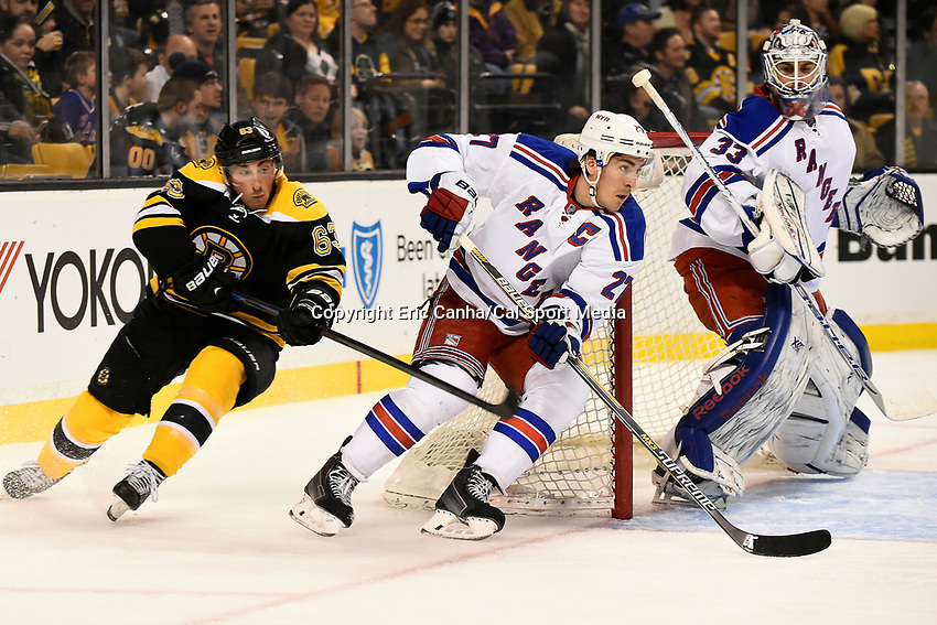 January 15, 2015 - Boston, Massachusetts, U.S. - Boston Bruins left wing Brad Marchand (63), New York Rangers defenseman Ryan McDonagh (27), and goalie Cam Talbot (33) in game action during the NHL match between the New York Rangers and the Boston Bruins held at TD Garden in Boston Massachusetts. The Bruins defeated the Rangers 3-0 in regulation time. Eric Canha/CSM