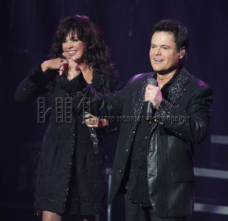 "Donny Osmond & Marie Osmond performing The Broadway Premiere of  ""Donny & Marie - A Broadway Christmas"" at the Marquis Theatre in New York City."