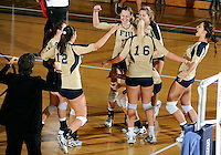 Florida International University women's volleyball players celebrate after the game against Arkansas State University.  FIU won the match 3-2 on October 21, 2011 at Miami, Florida. .