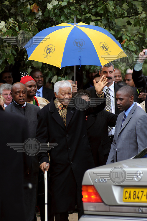Nelson Mandela arrives at the unveiling of Jean Doyle's commemorative bronze statue, unveiled outside the Groot Drakenstein Prison, where Mandela spent his final months before his release in 1990.