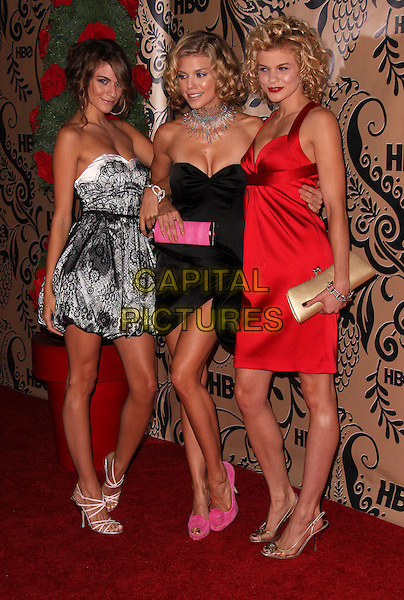 RACHEL, ANNALYNN & ANGEL McCORD.HBO Post Award Reception following the 61st Annual Primetime Emmy Awards held at the Pacific Design Center, West Hollywood, California, USA..September 20th, 2009.emmys full length black lace white strapless pink shoes red silk satin gold clutch bag dress sisters family .CAP/ADM/PZ.©Paul Zimmerman/AdMedia/Capital Pictures.