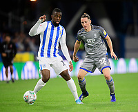 Huddersfield Town's Isaac Mbenza under pressure from Lincoln City's Aaron Lewis<br /> <br /> Photographer Chris Vaughan/CameraSport<br /> <br /> The Carabao Cup First Round - Huddersfield Town v Lincoln City - Tuesday 13th August 2019 - John Smith's Stadium - Huddersfield<br />  <br /> World Copyright © 2019 CameraSport. All rights reserved. 43 Linden Ave. Countesthorpe. Leicester. England. LE8 5PG - Tel: +44 (0) 116 277 4147 - admin@camerasport.com - www.camerasport.com