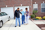 Karen Morris has been caring for her mother Gloria, 80, for the past 10 years. Her mother has Alzheimer's disease and lives with Karen and Karen's husband Richard in their Charlotte, NC home. She cleans under her mother's nails before getting her completely dressed. ..Richard and Karen walk with Gloria in the front yard in hopes of getting her moving on a slow morning...Mrs. Morris was a nurse before she retired and really enjoys taking care of people, she said. Every morning she washes her mother in the bathroom, helps her walk down the stairs, and they share breakfast, as they did Monday, October 18, 2010...Gloria was having an especially bad day and because Karen sees her every day, she knew something was wrong. She later discovered her medication was dehydrating her. That is one of many reasons why having a regular caretaker is so important. . .Kendrick Brinson.LUCEO.Model Released: Yes.AARP Contract #4859.Wichita/Bellovin Bulletin