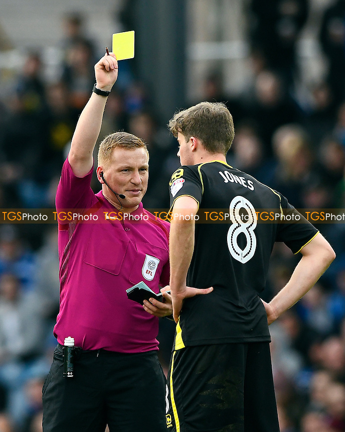 Referee John Busby gives a yellow card to James Jones of Crewe Alexandra during Portsmouth vs Crewe Alexandra, Sky Bet EFL League 2 Football at Fratton Park on 4th March 2017
