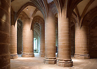 Crypte des Gros Piliers (Crypt of the massive pillars), each five metres in circumference, support those of the chancel of the abbey church, prism-shaped ribs of the vaulting flowing directly into the walls and pillars, 11th century, Le Mont Saint Michel, Manche, Basse Normandie, France. Picture by Manuel Cohen