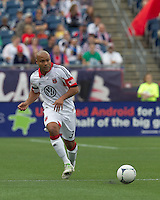 DC United defender Robbie Russell (3) passes the ball. In a Major League Soccer (MLS) match, DC United defeated the New England Revolution, 2-1, at Gillette Stadium on April 14, 2012.