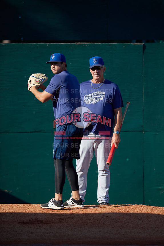 Pensacola Blue Wahoos pitching coach Danny Darwin (44) watches pitcher Tyler Mahle (31) warm up in the bullpen before a game against the Mobile BayBears on April 25, 2017 at Hank Aaron Stadium in Mobile, Alabama.  Mobile defeated Pensacola 3-0.  (Mike Janes/Four Seam Images)