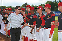 Batavia Muckdogs athletic trainer Eric Reigelsberger greets players Shane Sawczak (21) and Hunter Wells (35) during introductions before a game against the Auburn Doubledays on June 19, 2017 at Dwyer Stadium in Batavia, New York.  Batavia defeated Auburn 8-2 in both teams opening game of the season.  (Mike Janes/Four Seam Images)