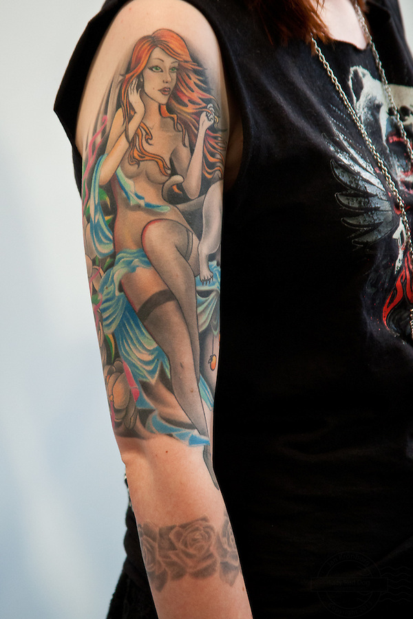 Copenhagen Inkfestival 2012. Pinup girl and black roses on arm.
