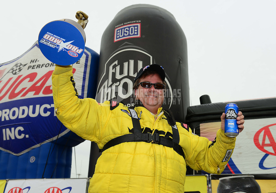 Sept. 30, 2012; Madison, IL, USA: NHRA pro mod driver Troy Coughlin celebrates after winning the Midwest Nationals at Gateway Motorsports Park. Mandatory Credit: Mark J. Rebilas-