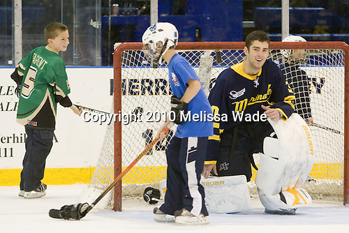 Sam Marotta (Merrimack - 30) lets some young fans fire gloves at him in net. - The Merrimack College Warriors defeated the visiting Sweden Under 20 team 4-1 on Tuesday, November 2, 2010, at Lawler Arena in North Andover, Massachusetts.
