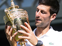Novak Djokovic (SRB) with the Wimbledon Gentlemen's singles Trophy after becoming the 2018 Champion