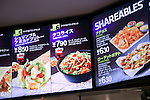 Pictures of the shrimp and avocado burrito and taco rice dishes on display at the new Taco Bell restaurant during the pre-opening event for their first Japanese store located in Tokyo's Shibuya district, on April 20, 2015, Japan. The store includes Japan specific dishes like shrimp and avocado burrito and taco rice on its menu. It will open to the public on April 21st. The American Tex-Mex fast food restaurant has signed a franchise agreement with Asrapport Dining Co., Ltd. to operate Taco Bell branches in Japan. (Photo by Rodrigo Reyes Marin/AFLO)