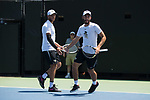 Bar Botzer (left) and Petros Chrysochos of the Wake Forest Demon Deacons slap hands during their match at #2 doubles against the South Carolina Gamecocks during Round Two of the 2018 NCAA Men's Tennis Championship at the Wake Forest Tennis Center on May 13, 2018 in Winston-Salem, North Carolina.  The Demon Deacons defeated the Gamecocks 4-1.  (Brian Westerholt/Sports On Film)