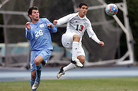 SMU's Paulo da Silva (13) plays the ball away from UNC's Ted Odgers (26). Southern Methodist University defeated the University of North Carolina 3-2 in double overtime at Fetzer Field in Chapel Hill, North Carolina, Saturday, December 3, 2005.