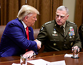 United States President Donald J. Trump, left, shakes hands with US Army General Mark A. Milley, Chairman of the Joint Chiefs of Staff, right, as he participates in a briefing with senior military leaders in the Cabinet Room of the White House in Washington, DC on Monday, October 7, 2019.<br /> Credit: Ron Sachs / Pool via CNP