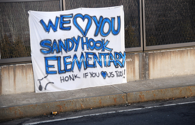 NEWTOWN, CT, 15 DEC 12-121512AJ04-Around Newtown signs of hope hang from fences, in front of homes and churches following Friday's mass murder at Sandy Hook Elementary School. Alec Johnson/ Republican-American