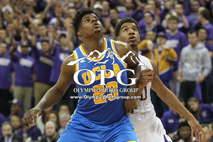 JAN 1, 2016:  Washington #0 Marquese Chriss and UCLA's #23 Tony Parker set up under the basket.  Washington defeated #25 ranked UCLA 96-93 in double overtime at Alaska Airlines Arena in Seattle, WA.