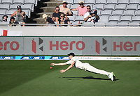 Craig Overton dives in an attempt to dismiss Southee.<br /> New Zealand Blackcaps v England. 1st day/night test match. Eden Park, Auckland, New Zealand. Day 4, Sunday 25 March 2018. &copy; Copyright Photo: Andrew Cornaga / www.Photosport.nz