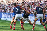 Roger Tuivasa-Sheck taken in a big tackle. Sydney Roosters v Vodafone Warriors, NRL Rugby League. Allianz Stadium, Sydney, Australia. 31st March 2018. Copyright Photo: David Neilson / www.photosport.nz