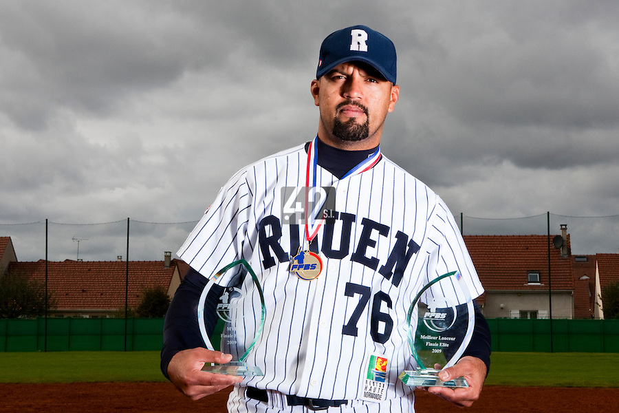 10 october 2009: Keino Perez of Rouen poses with the MVP trophy of the 2009 championship finals and the Best Pitcher award after game 4 of the 2009 French Elite Finals won 7-2 by Huskies of Rouen over Lions of Savigny, at Stade Jean Moulin stadium in Savigny sur Orge, near Paris, France. Rouen wins the 2009 France championship, his sixth title.