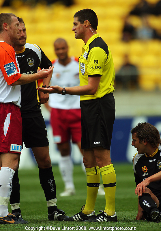 The team captains Craig Moore and Andrew Durante discuss a foul on Jon McKain during the A-League football match between the Wellington Phoenix and Queensland Roar at Westpac Stadium, Wellington. Sunday, 26 October 2008. Photo: Dave Lintott / lintottphoto.co.nz