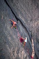 Two climbers rock climbing.