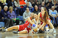 SNESH21P<br /> From left, Neshaminy's Devon Storms, North Penn's Irisa Ye and Neshaminy's Morgan Goldenbaum wrestle for a loose ball in the fourth quarter of a playoff basketball game  Friday March 11, 2016 in Royersford, Pennsylvania.  (William Thomas Cain/For The Inquirer)