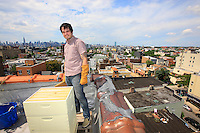 "Eddie Diaz, 31 years old, is a new beekeeper. He started in January with two hives set up on the roof of a building on Lorimer Street in Brooklyn. ""We are a group of more or less 25 people that got together by chance, we must total about a hundred hives in Brooklyn. On my count, there must be nearly 1000 hives in New York at present. It's still underground, informal. But we are taking very seriously the present revolution. Lots of young people are throwing themselves into alternative organic farming projects in the community gardens, or else the rooftop gardens. Some even plan to buy land outside New York City… People need to feel in touch with nature. I work in an organic restaurant which grows nearly half of its vegetable in terraced gardens""."