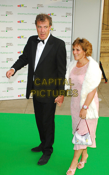 JEREMY CLARKSON & GUEST.At the Dream Auction Full Stop - VIP Party, primarily to launch children's charity NSPCC's There4Me online sevice. Held at the Royal Albert Hall, London, UK..May 9th 2006.Ref: CAN.full length tuxedo pink white fur dress.www.capitalpictures.com.sales@capitalpictures.com.©Capital Pictures