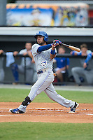 Juandy Mendoza (10) of the Bluefield Blue Jays follows through on his swing against the Burlington Royals at Burlington Athletic Stadium on June 27, 2016 in Burlington, North Carolina.  The Royals defeated the Blue Jays 9-4.  (Brian Westerholt/Four Seam Images)