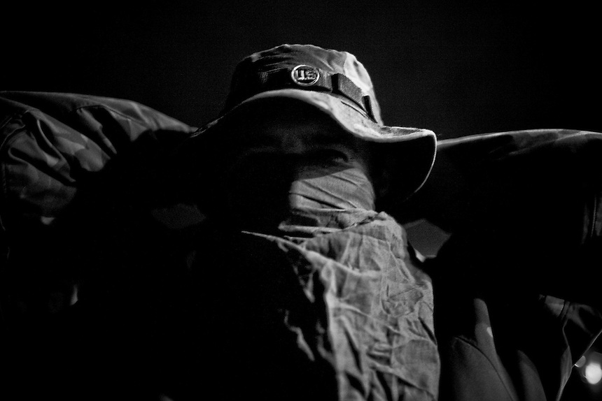 A member of the Idaho Light Foot Militia ties a handkerchief over his face before embarking on an overnight training exercise in the mountains near Clark Fork, Idaho.
