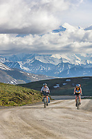 To women biking along the Denali Park Highway, Mount McKinley visible in the distance.