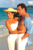 Romantic couple embrace on beach, Caribbean.
