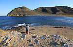Woman looking at view Playa de Playazo, Rodalquilar, Cabo de Gata natural park, Almeria, Spain